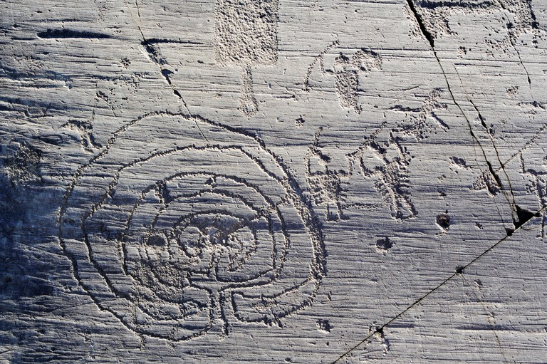 Etruscan rock drawing with labyrinth, warrior and scoop, iron age, Naquane, Val Camonica, UNESCO World Heritage Site Val Camonic