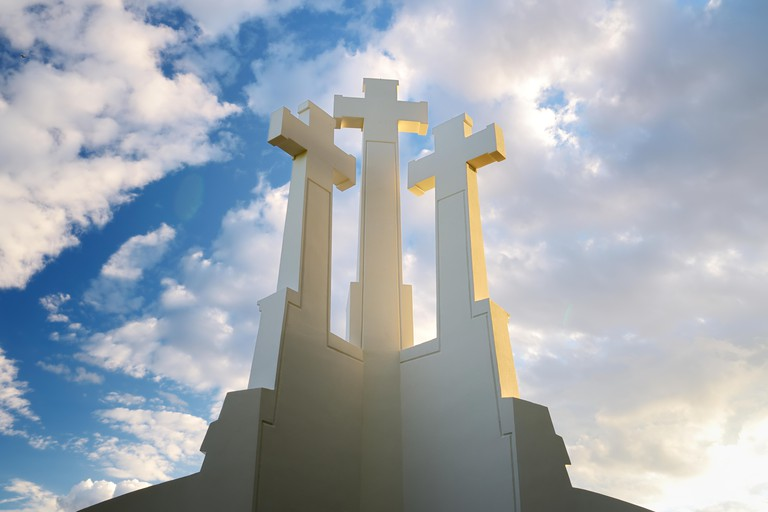 The Three Crosses monument overlooking Vilnius Old Town on sunset