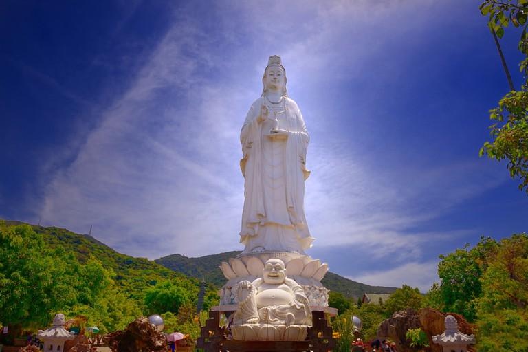 The white statue of Guan Yim Buddha standing at Chua Linh Ung Bai But Temple, Da Nang, Vietnam.
