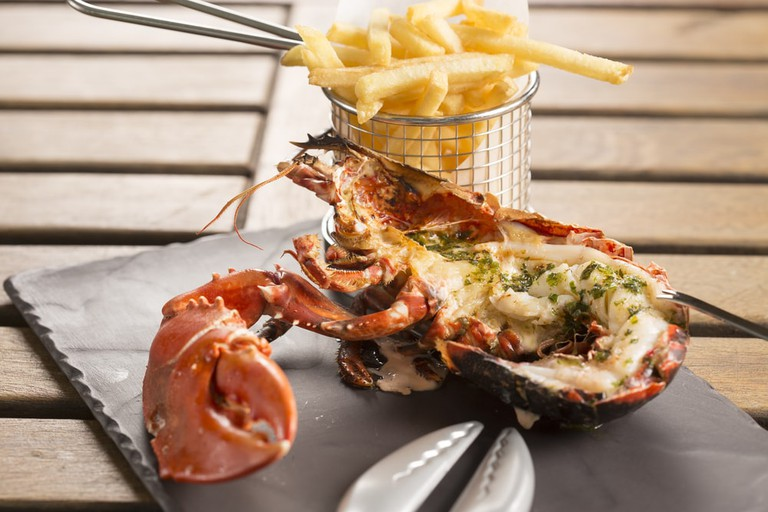 Half grilled lobster with herb butter & fries