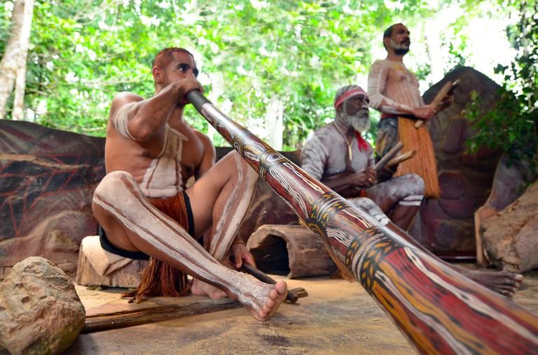 Yirrganydji Aboriginal men play Aboriginal music on didgeridoo in Queensland, Australia.