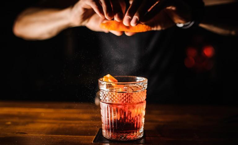 Bartender preparing cocktail at the bar.