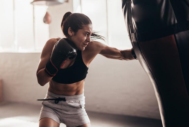 Female boxer hitting a punching bag