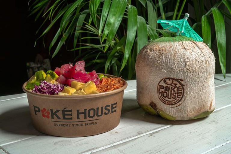 A poke bowl and fresh coconut
