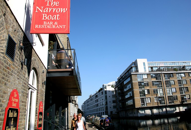 Narrowboat pub/restaurant on banks of Regents Canal, Islington, London.