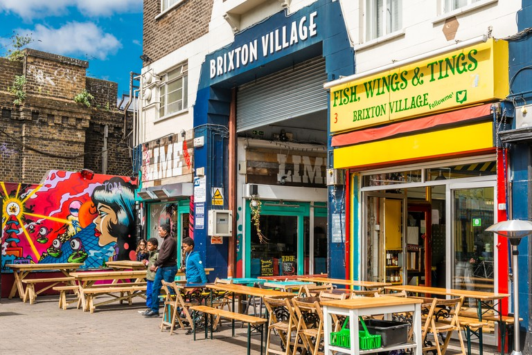 London, United Kingdom - May 14, 2016: Brixton Village and Brixton Station Road Market. Colorful and multicultural community mar