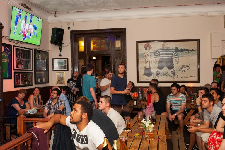 French, Scottish and England rugby fans watch a world cup warm up game against France in the Faltering Fullback pub in Finsbury Park, north London.