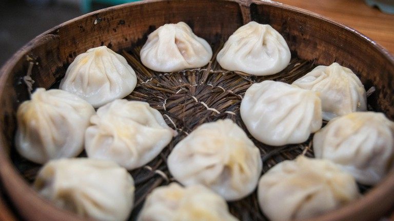 A basket of steamed xiaolongbao soup dumplings at Jia Jia Tang Bao on Shanghai's Huanghe Road.