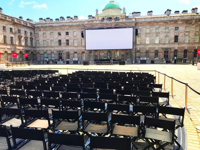 Outdoor cinema in the sunlit courtyard of Somerset House, London, England.