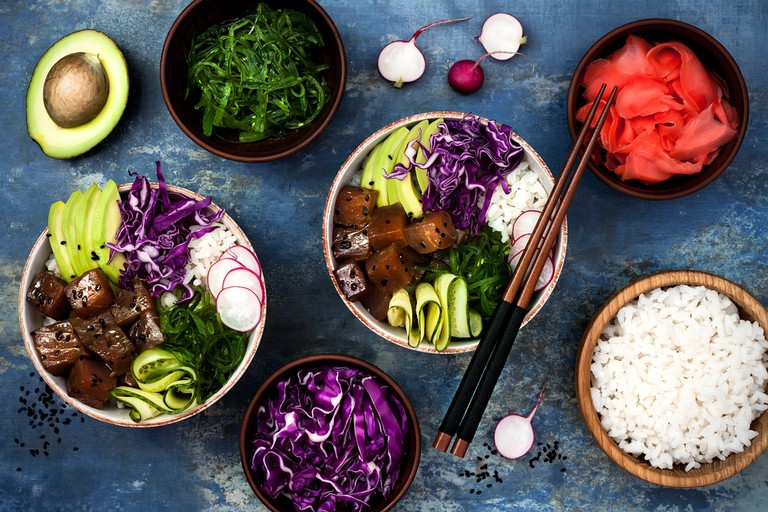 Hawaiian tuna poke bowl with seaweed, avocado and red cabbage.