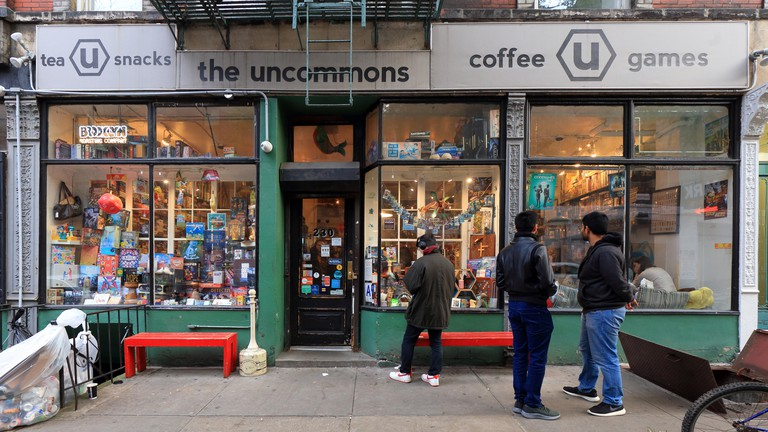 The Uncommons, 230 Thompson Street, New York, NY. exterior storefront of a boardgame, gaming cafe in the Greenwich Village neighborhood of Manhattan.. Image shot 11/2019. Exact date unknown.