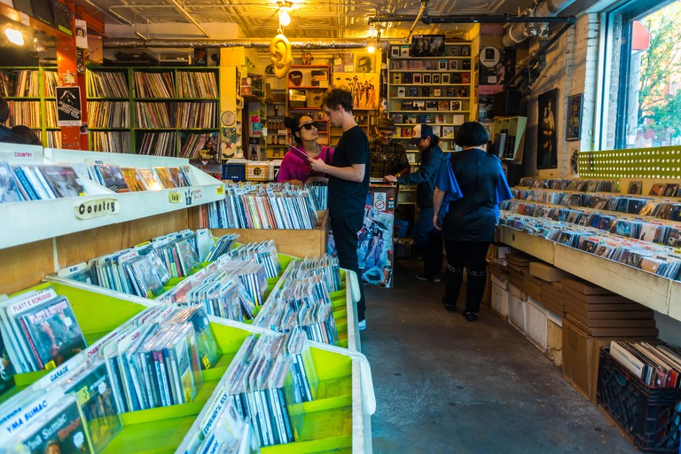 New York City, USA, Young Man Shopping for Music Records in Vintage Record Vinyl Store, Brooklyn, Earwax. Image shot 2015. Exact date unknown.