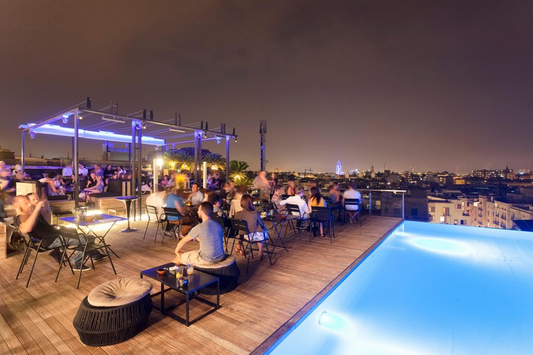 A bar in Barcelona: a roof terrace with a view of the Torre Agbar at the Grand Hotel Central, Catalonia, Spain