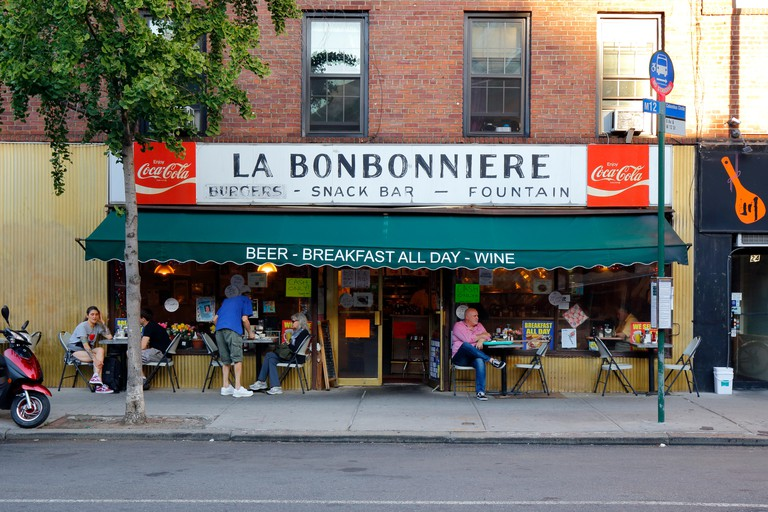 La Bonbonniere, 28 8th Ave, New York, NY. exterior storefront of a restaurant, and sidewalk cafe in the Greenwich Village neighborhood of Manhattan.. Image shot 06/2018. Exact date unknown.