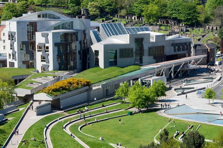A view of the Scottish Parliament at Holyrood and Calton Hill behind, Edinburgh, Scotland.