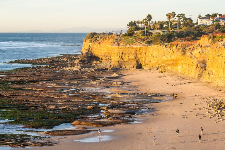 People on North Garbage Beach on a January afternoon. Sunset Cliffs Natural Park, San Diego, California, USA.