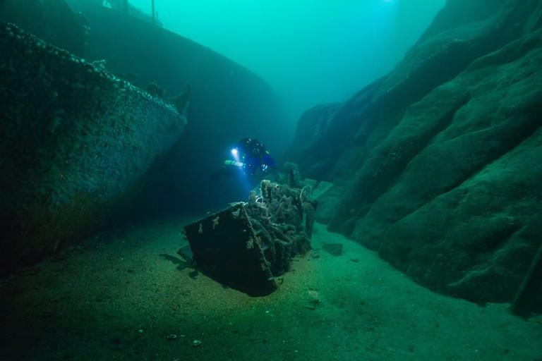Scuba diving in one of the shipwrecks in Gulen, Courtesy of Gulen Diving Resort