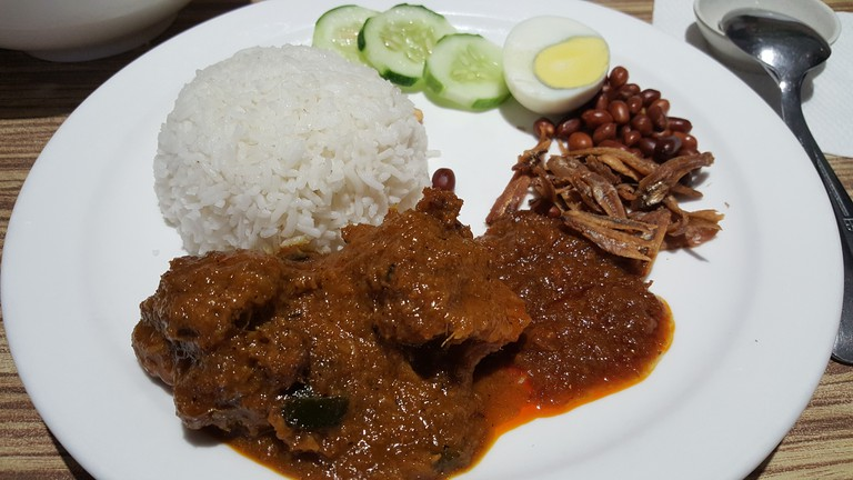Malaysian local food Nasi lemak with curry chicken.
