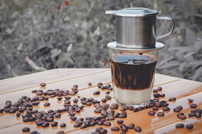 Vienna coffee, black coffee and coffee beans.