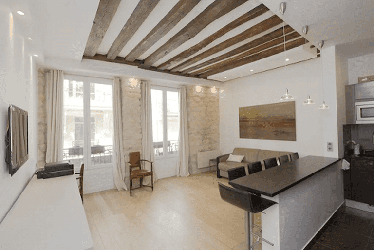 Old and new features blend perfectly in this sleek apartment in Le Marais