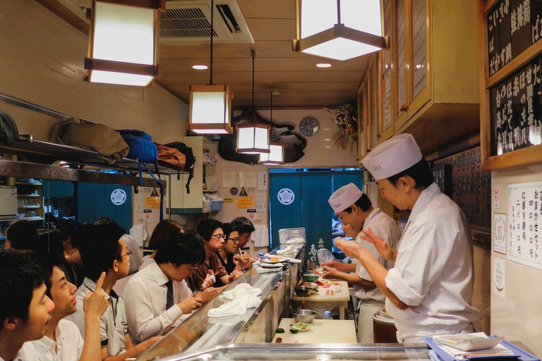Local japanese workers eating at famous dai restaurant