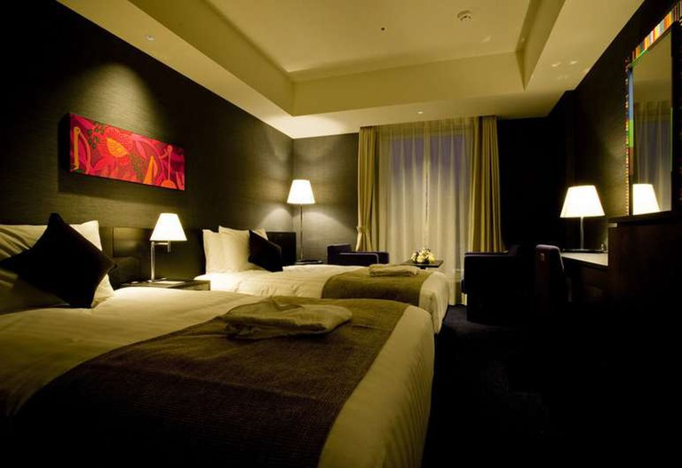Each of The Gate Hotel's rooms and suits are individually designed