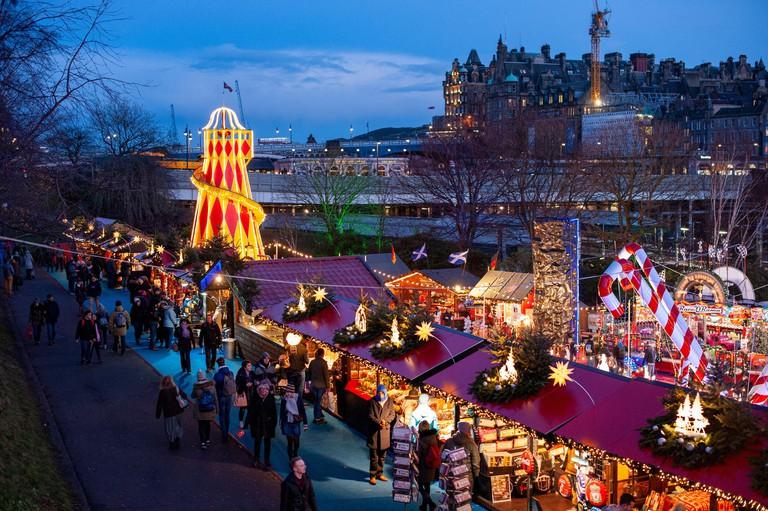 Edinburgh Christmas market in blue hour light. Edinburgh cityscape/travel photograph by Pep Masip.