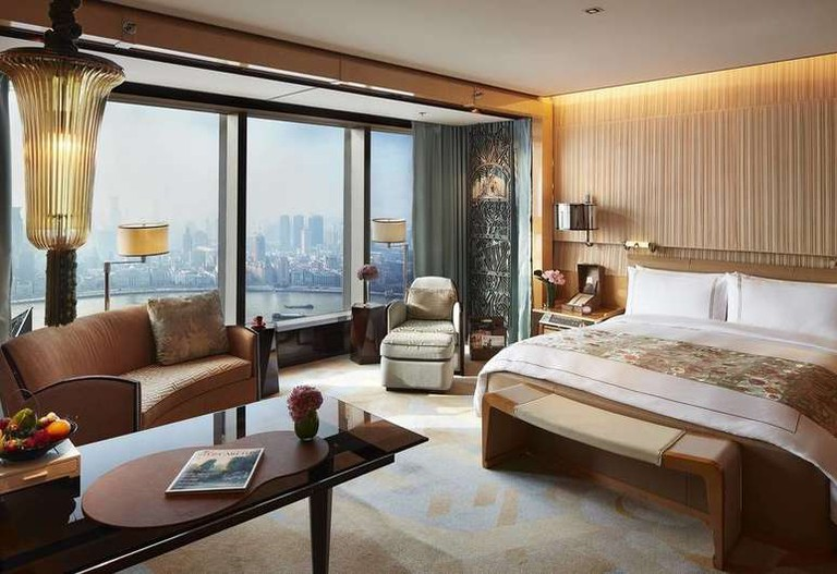 Each room at The Ritz-Carlton Shanghai, Pudong, comes with a huge television and a Bose surround sound system