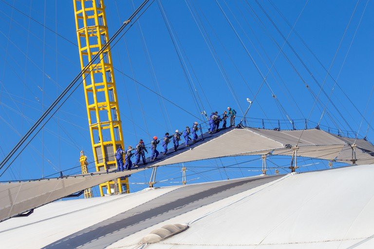 Up at the O2, people climbing the dome roof, Millennium Dome, Greenwich, London