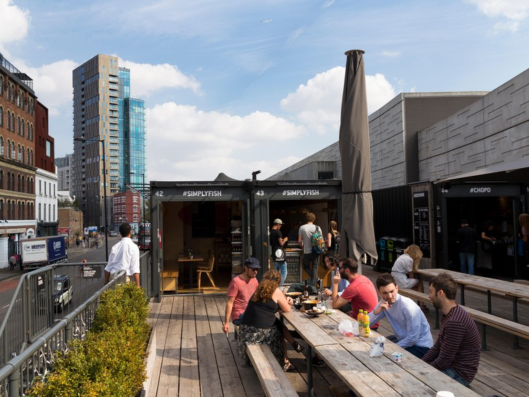 Street food in Shoreditch on roof of the container shops of Boxpark.