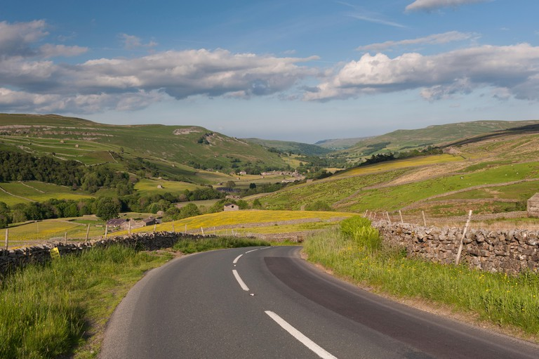 Road into Thwaite from the Buttertubs, Swaledale, North Yorkshire, UK.