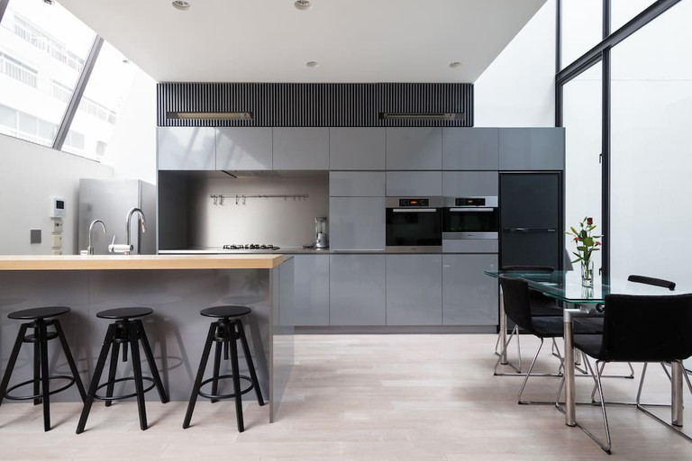 This house features open, brightly lit spaces and modern design and appliances