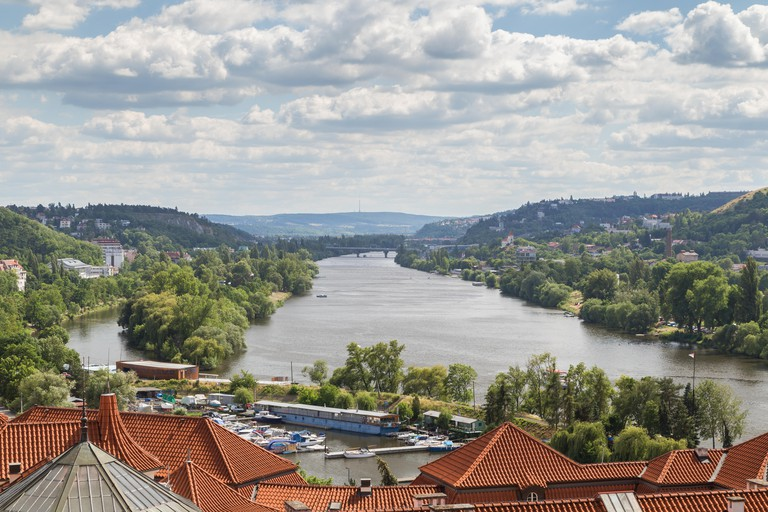Vltava River in Prague, Czech Republic, viewed from the Vysehrad fort on a sunny day.