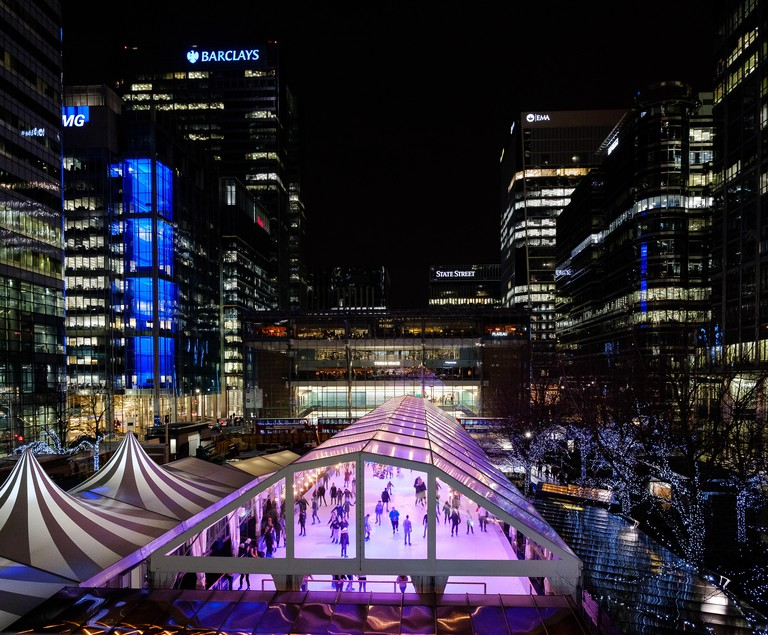 A view over the Canada Square Ice rink during the Winter Lights Festival at Canary Wharf
