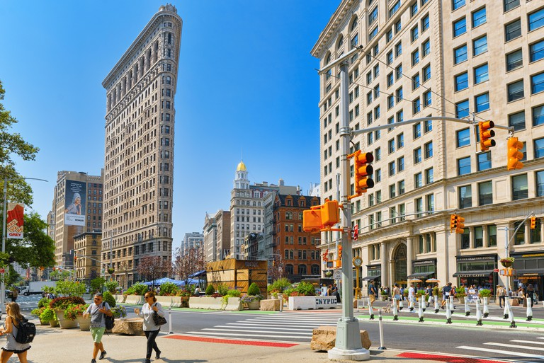 New York, USA- September 05, 2017 : Flatiron Building on 5th Avenue near Madison Square Park. Urban views of New York. Street, people and tourists on