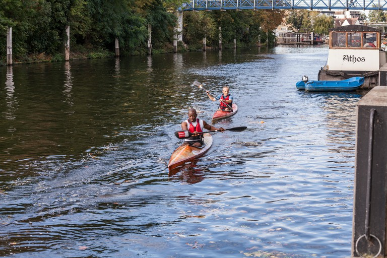 Two canoeists on the River Thames in Teddington, London