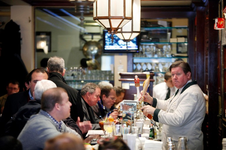 Diners eat lunch at Wollensky's Grill, inside the famed New York steakhouse Smith and Wollensky, New York, NY.