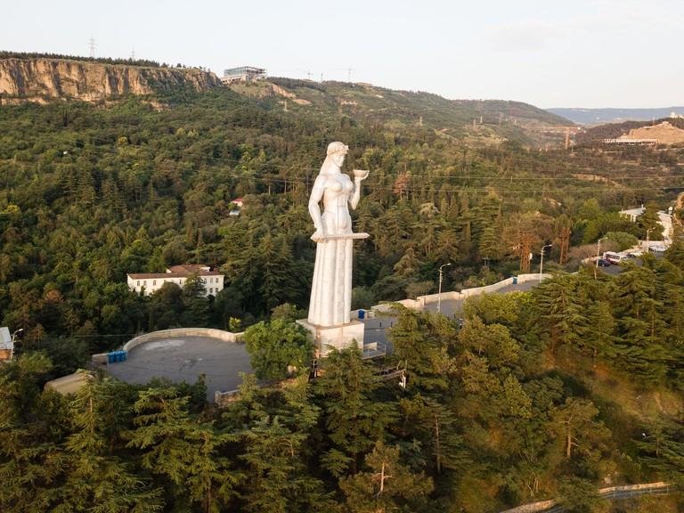 Tbilisi, Georgia - June 16, 2018: Aerial view from drone to Monument Mother of Georgia Kartlis Deda by Georgian sculptor Elguja Amashukeli. Erected on