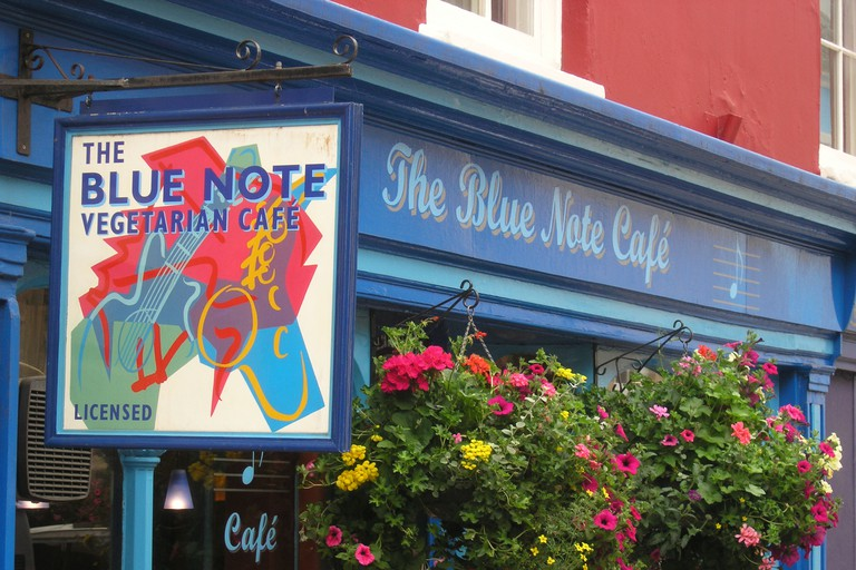 shop sign at The Blue Note Cafe Glastonbury town Somerset England