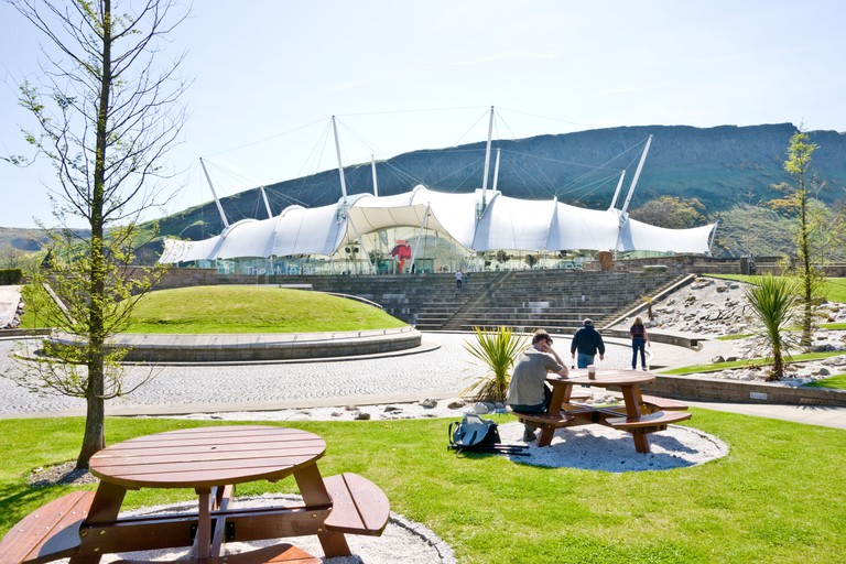 Our Dynamic Earth Edinburgh Scotland with Salisbury Crags in the background.