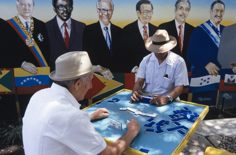 Latin men playing dominos at Domino Park, Little Havana, Miami. Slow down in Little Havana at this famous Cuban landmark, popular with visitors and locals alike