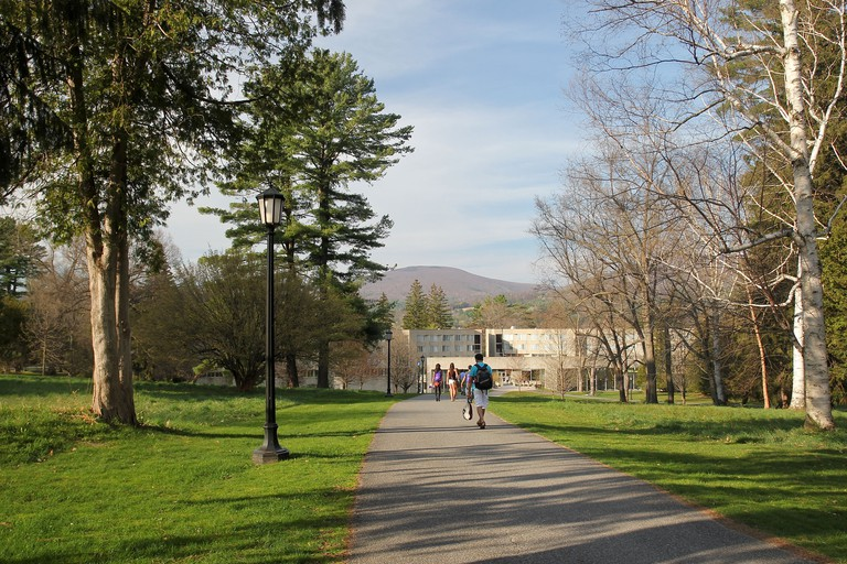 Students walk down a tree-lined path towards a building on the Williams College campus, Williamstown, Massachusetts