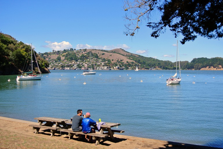 couple have picnic lunch on tables in ayala cove on Angel Island