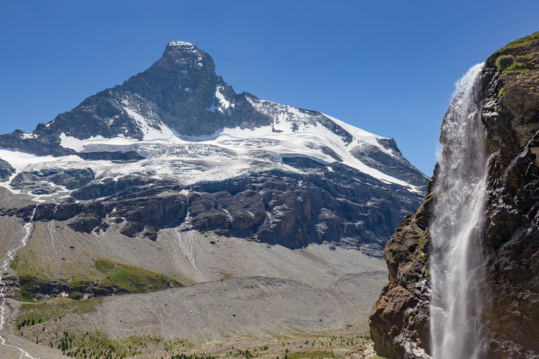 The Arbenbach Falls is backdropped by the Matterhorn