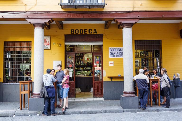 People at Bar Bodega Las Columnas in Santa Cruz district, Seville, Andalusia, Spain