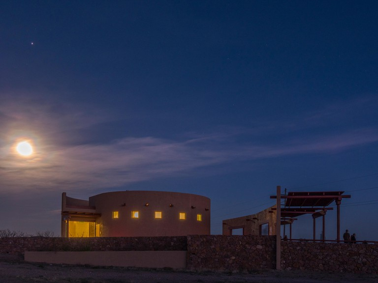 Nearly full moon over Marfa Lights Viewing Center, Marfa, Texas.
