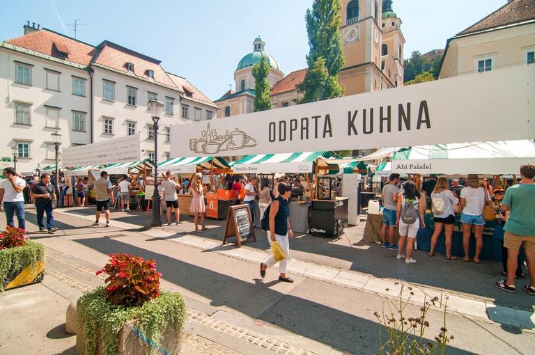 Ljubljana, Slovenia - September 2, 2016 People walking and eating at an Open kitchen, Ljubljana, Slovenia