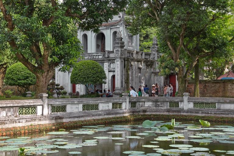 Lotus pond and main gate of the Temple of Literature, Hanoi, Vietnam