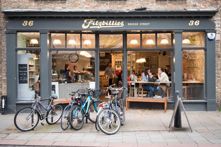 The new Fitzbillies restaurant and cafe in Bridge Street Cambridge UK at dusk with interior lights glowing