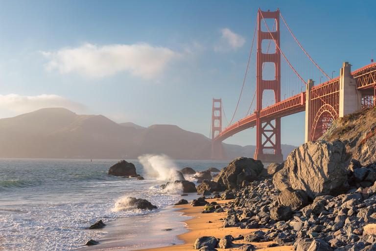 Golden Gate Bridge at sunset seen from the Beach